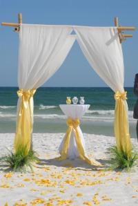 Yellow Barefoot bamboo beach wedding arbor